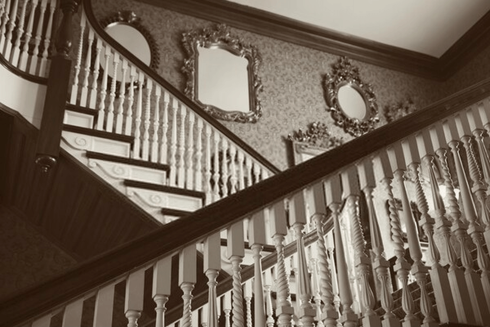 mirror at bottom of the stairway