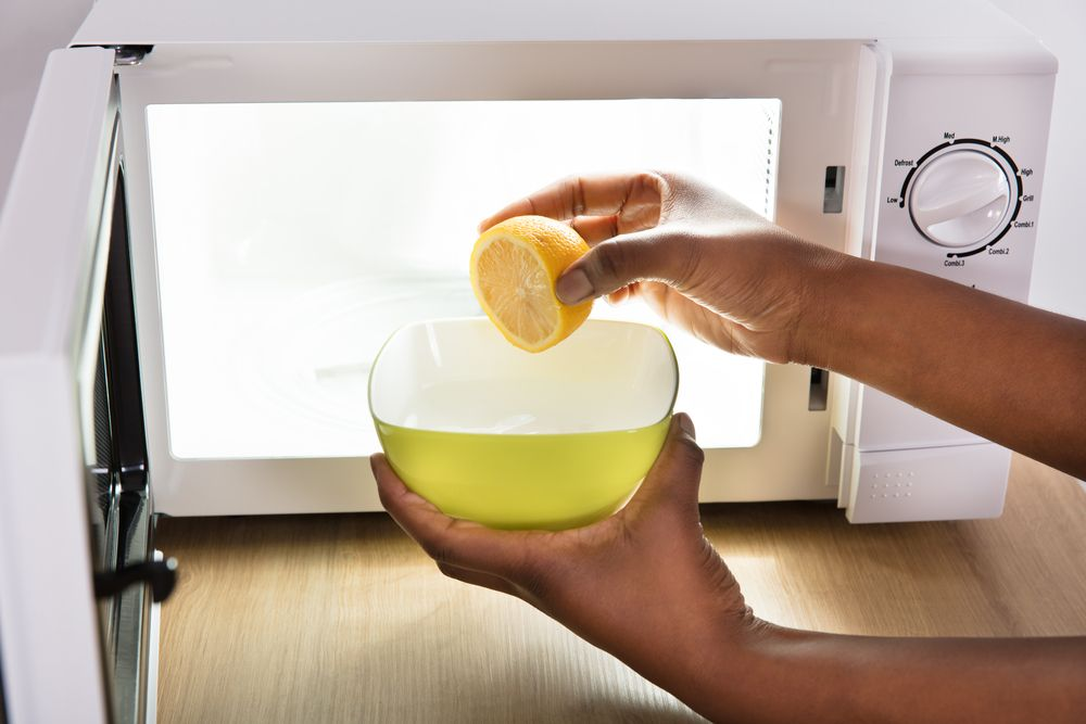 Cleaning Microwave with Lemon